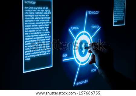 Business man working touch monitor - stock photo