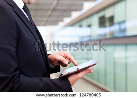 Business man working with a digital tablet at modern office - stock photo