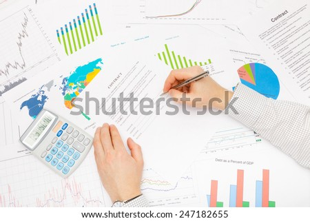 Business man working with financial data - ready to sign contract - stock photo