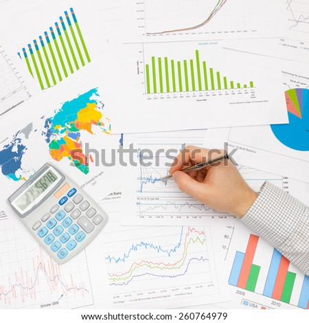 Business man working with financial data - studio shot - stock photo