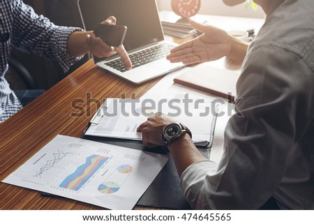 Business man working with stress at office with laptop and documents on his desk