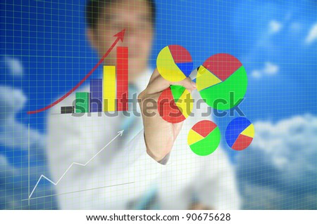 Business man write graph on transparent  touch screen - stock photo