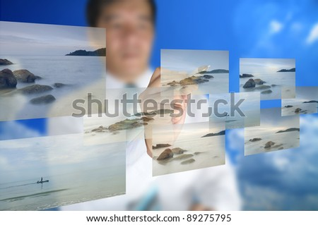 Business man write on touch screen display - stock photo