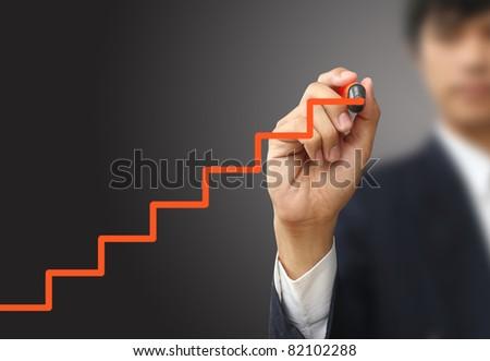 Business man write stair - stock photo