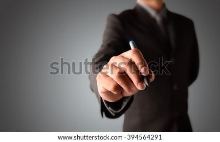 business man writing - stock photo