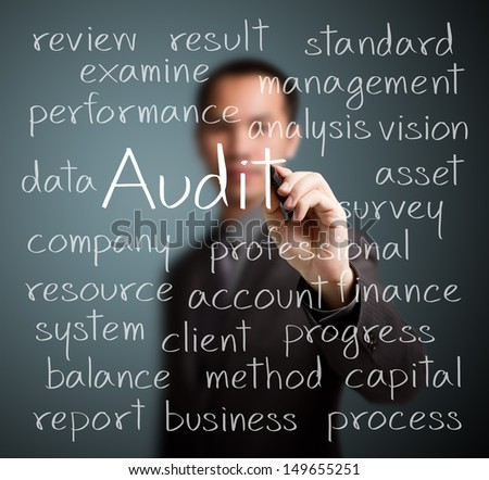 business man writing audit concept - stock photo