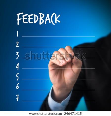 business man writing blank feedback list. business man writing feedback concept - stock photo