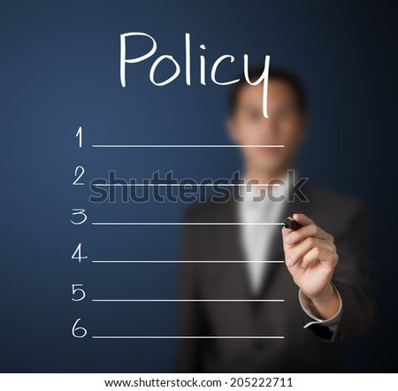 business man writing blank policy list - stock photo