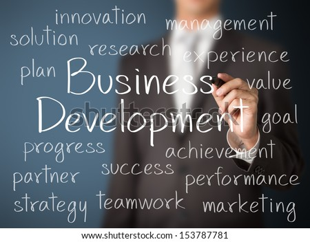 business man writing business development concept - stock photo