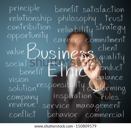 business man writing business ethic concept - stock photo