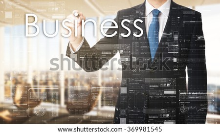 business man writing business on transparent board in office - stock photo