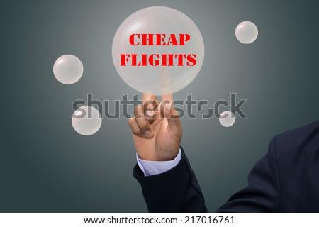 business man writing CHEAP FLIGHTS - stock photo