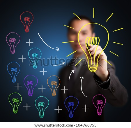 business man writing concept of  combining of many different small idea is one big great idea - stock photo