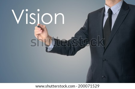 business man writing concept of vision on blue background - stock photo