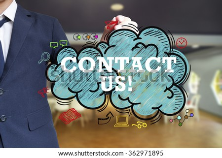 business man writing CONTACT US  over the cloud with office background , business concept , business idea - stock photo