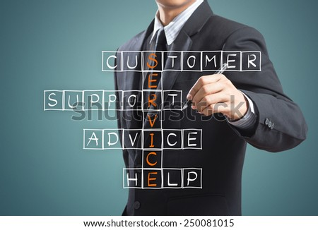 Business man writing customer service concept - stock photo