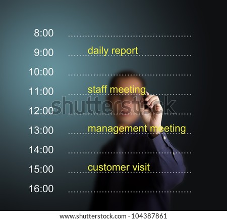 business man writing daily appointment schedule - stock photo