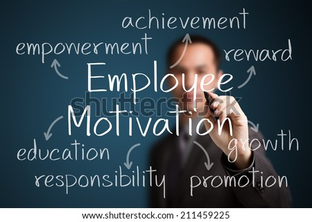 business man writing employee motivation concept