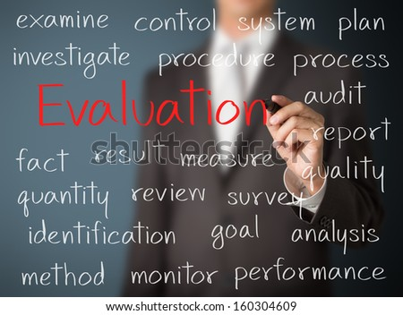 business man writing evaluation concept - stock photo