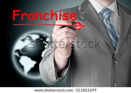business man writing franchise