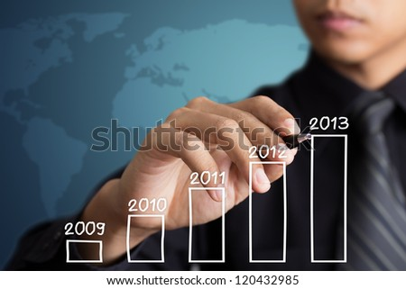 business man writing 2013 graph - stock photo