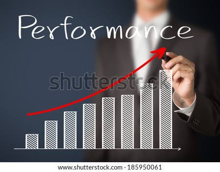 business man writing growth graph of performance - stock photo