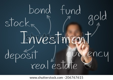 business man writing investment alternative - stock photo