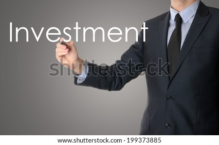 business man writing investment concept  - stock photo
