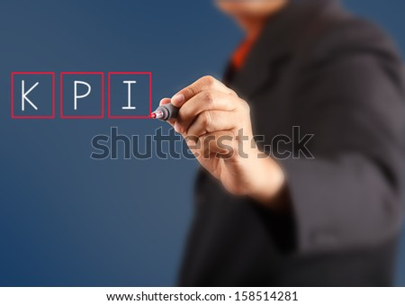business man writing key performance indicator ( KPI ) concept  - stock photo