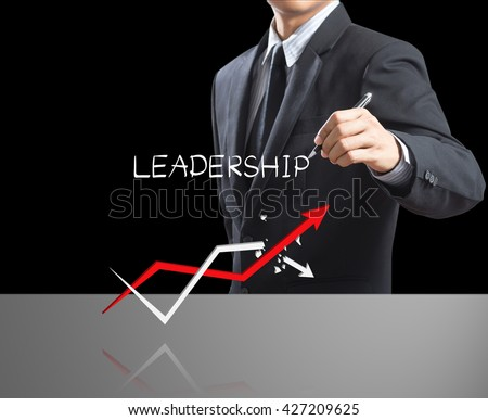 Business man writing leadership concept with growth arrow, Leadership concept