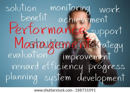 business man writing performance management concept
