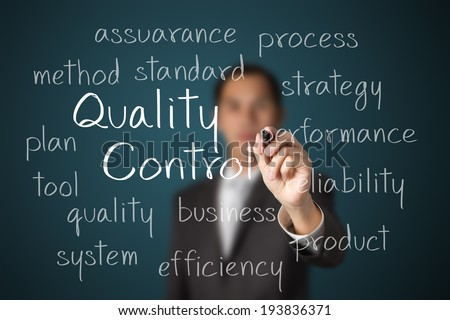 business man writing quality control concept - stock photo
