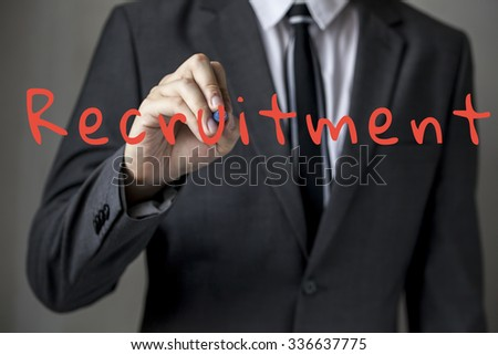 Business man writing recruitment concept