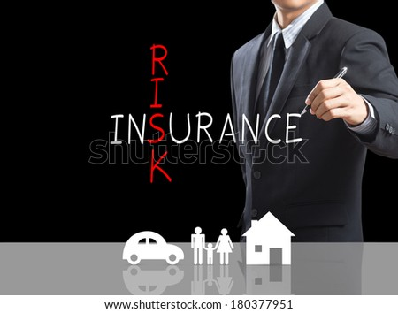 Business man writing Risk Insurance crossword with, insurance concept - stock photo