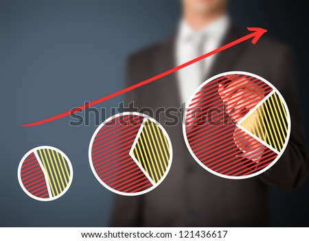 business man writing sharing growth by pie chart