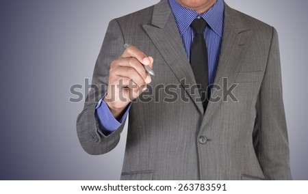business man writing  something on virtual screen - stock photo