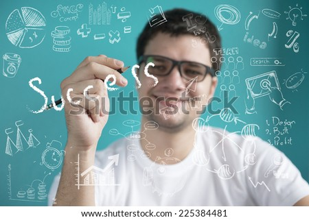 business man writing success concept ,Portrait of a handsome young man writing on glass board  - stock photo