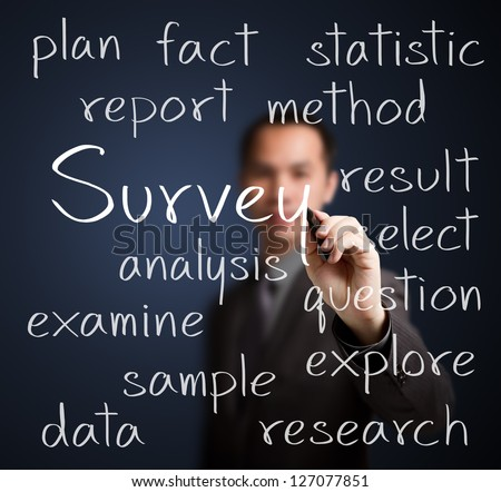 business man writing survey concept - stock photo