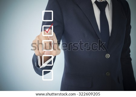 Business man writing tick white box , business idea conctept