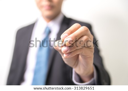Business man writing touch screen PC on white background