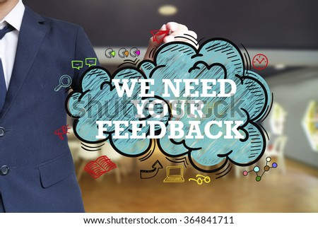 business man writing WE NEED YOUR FEEDBACK over the cloud with office background , business concept , business idea - stock photo