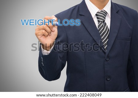 business man writing WEIGHT LOSS - stock photo