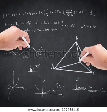 Business man writing with chalk against blackboard - stock photo