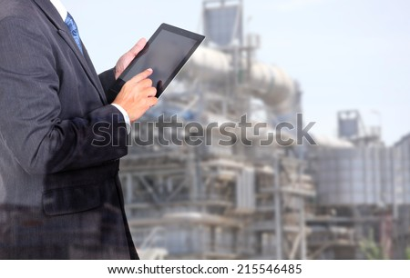 Business management man on oil factory area site  - stock photo