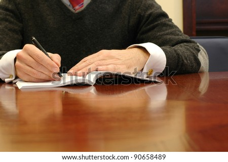 Business manager writing in board room, business concept