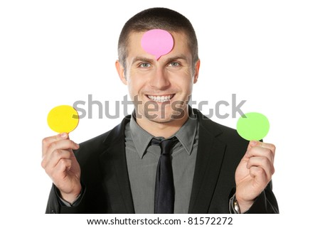 Business mane in suit with thought bubble, looking on camera - stock photo