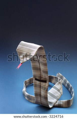 Business mans tie in the shape of a snake with a red tongue on blue background - stock photo