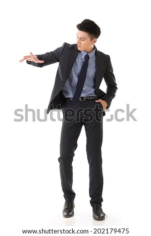 Business marionettes concept by Asian young executive holding or control something. - stock photo