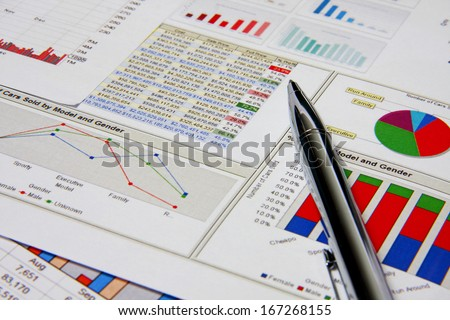 Business marketing chart with silver pen on table.