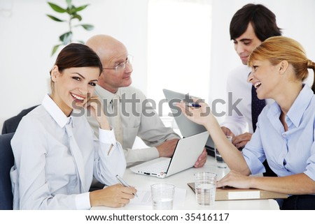 business meeting, ambitious young woman looking at camera - stock photo